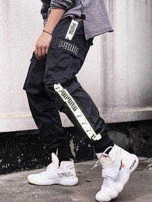 图1_Puma彪马3M反光织带串标工装裤 这条工装裤满足大家随时随地洒脱无束缚的耍酷 敲有趣的是侧沿 对称的贴袋 两腿侧设计反光织带 敲有设计感 看上去增添一份潮流感 脚口设计罗纹小脚口柔软舒适的面料 版型绝对满足你对工装裤的想象 颜色 黑色 M L XL XXL