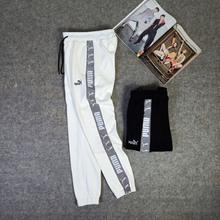 图2_彪马puma加绒款串标反光情侣卫裤 采用3m反光材料 420克复合绒 版型超好 加厚不臃肿 让你在这个冬天既时尚潮流又不失温暖 男女上身都好看哦 颜色 黑色 白色尺码 S M L XL XXL XXXL